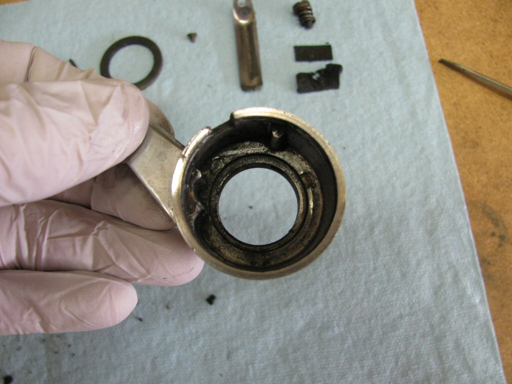 Empty throttle body. You can see the protrusions that keep the rubber friction material and metal backing plate from rotating when the throttle tube is rotated.