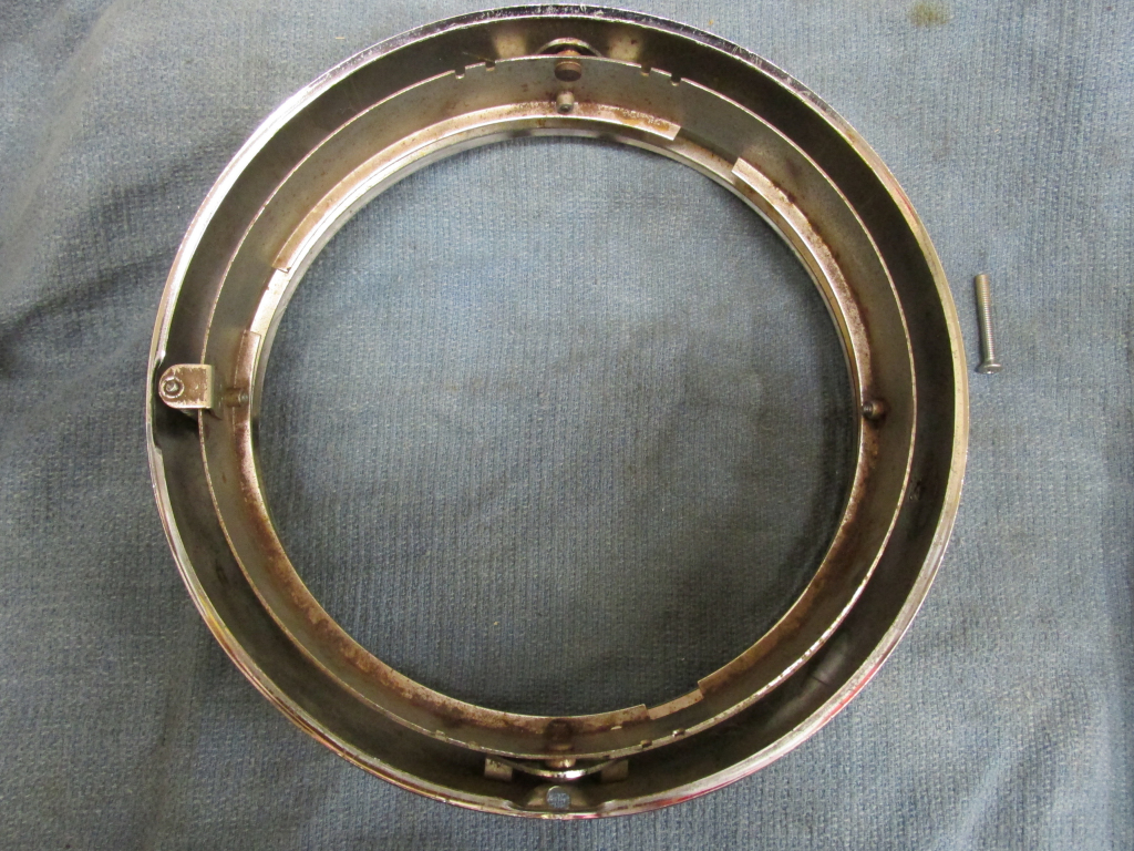 Inner and out rings. Moto Guzzi headlight as commonly fit to many 1970's Tonti models.