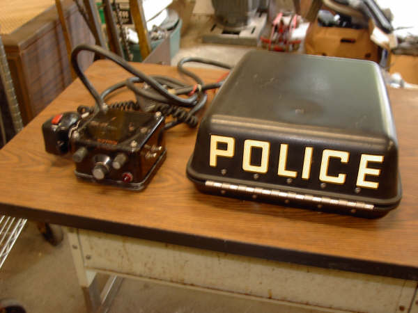 MCR-100 head unit, microphone, cables, and fiberglass box. The police marking has to be removed or covered up. I've heard of some people using the marking POLITE but I think that's risky.