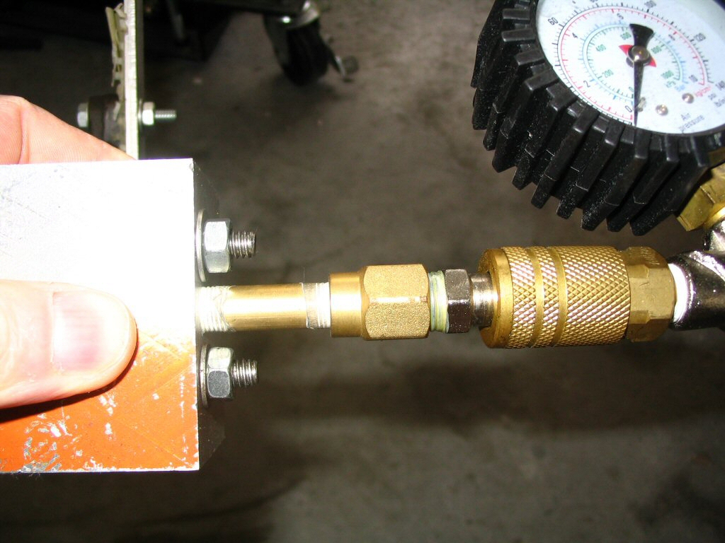 Pressure tester for an oil pressure relief valve.