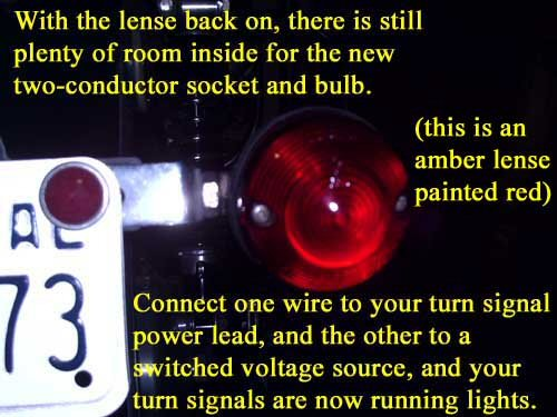 With the lens back on, there is still plenty of room inside for the new two-conductor socket and bulb. This is an amber lens painted red. Connect one wire to your turn signal power lead, and the other to a switched voltage source, and your turn signals are now running lights.