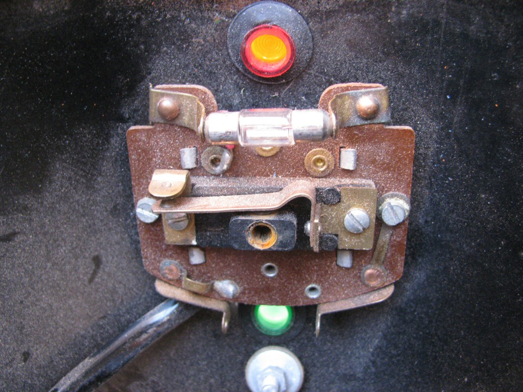 Key switch and indicator lights at the top of the headlight bucket as fit to a Moto Guzzi Astore.