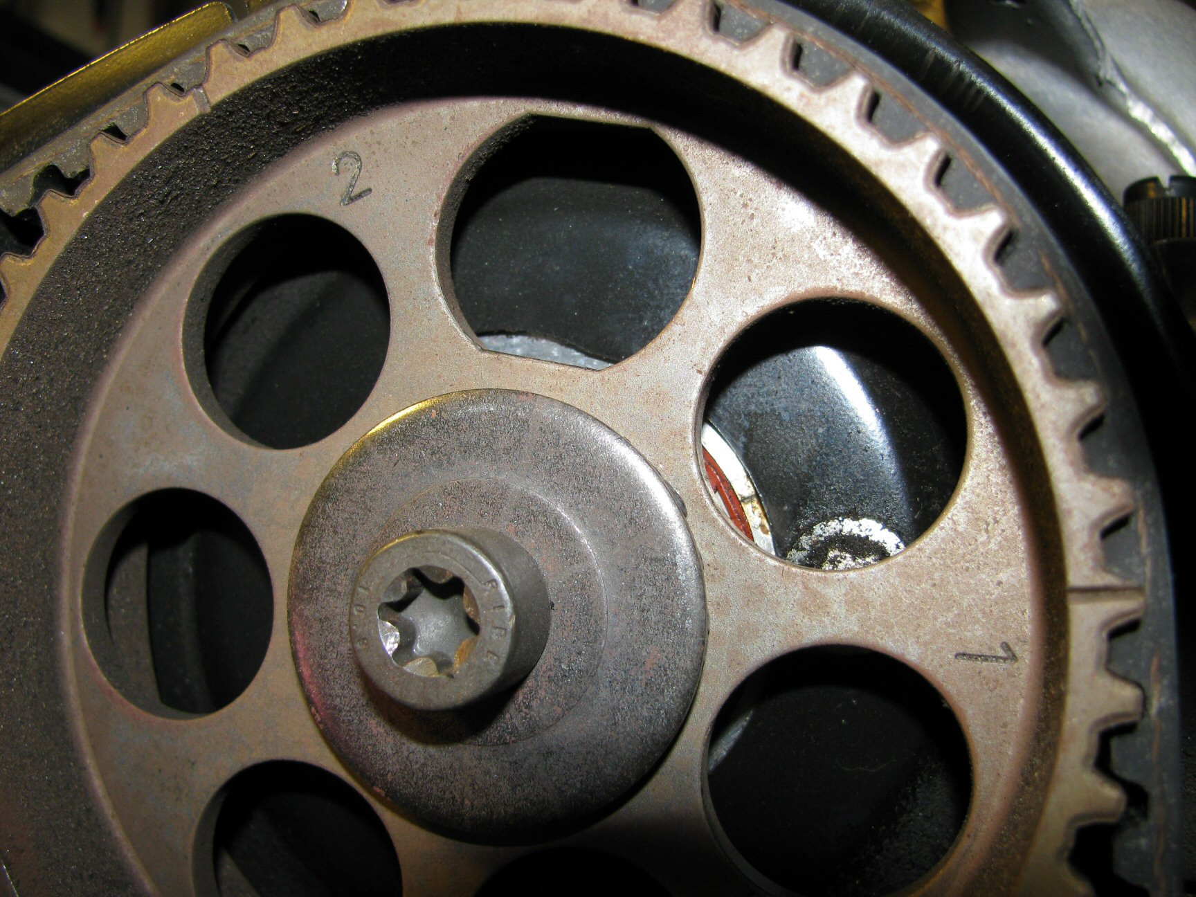 Camshaft pulley 2 aligned with notch in backing tin.