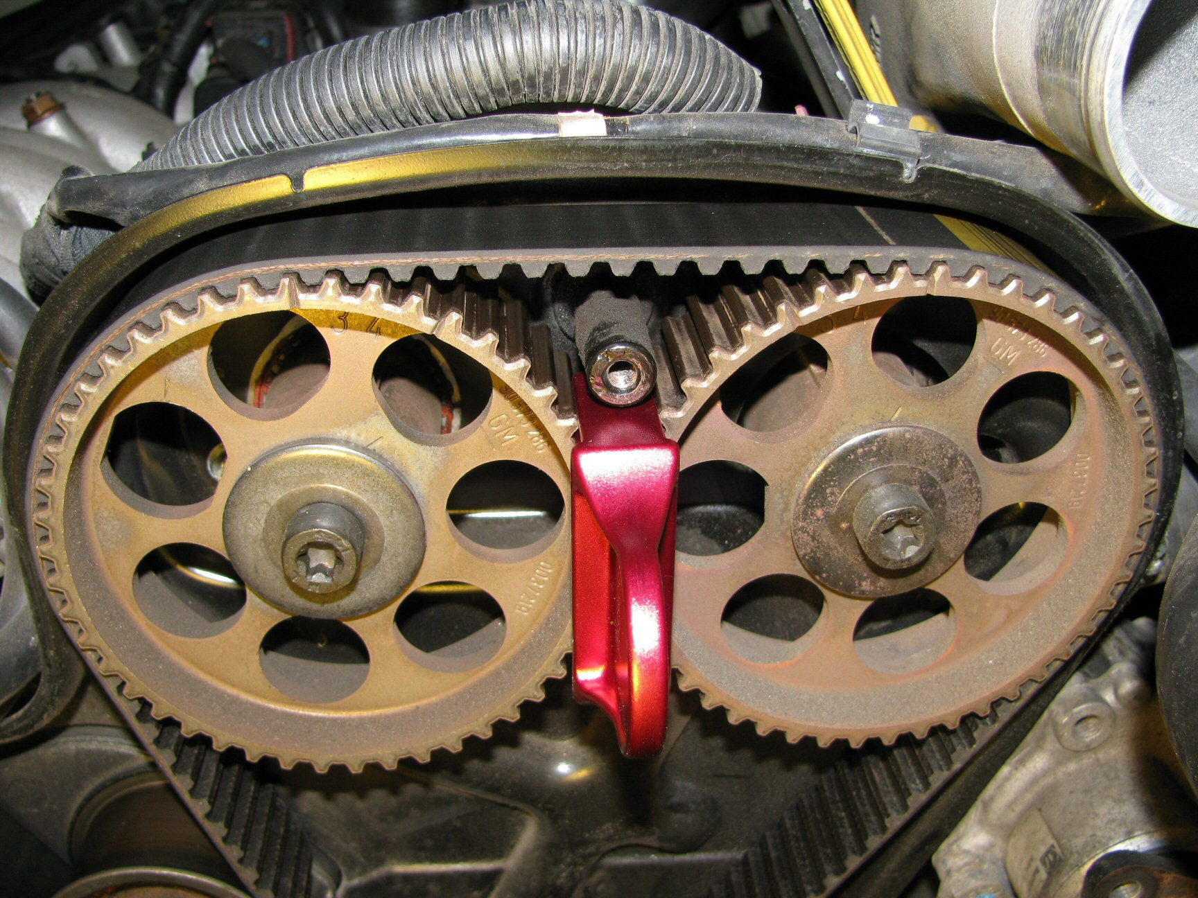 Camshaft pulleys 3 (left) and 4 (right).